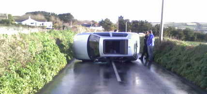 Overturned car tuesday