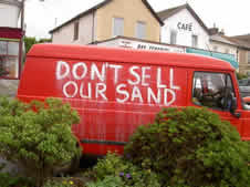 Save Our Sand on the side of a parked van